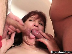 poker-playing-granny-swallowing-two-big-cocks