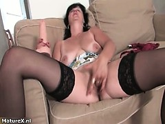 horny-mature-brunette-woman-sucks-dildo-part3