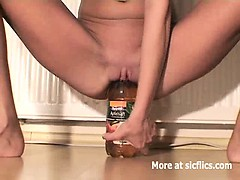 skinny-slut-fucking-huge-bottles