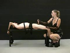 blonde mistress jerks off her tied up slave and demands for