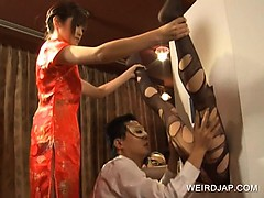 japanese-sweetie-getting-feet-licked-on-gloryhole