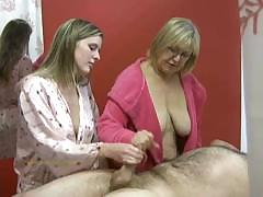 senior-masseuse-helps-junior-masseuse-in-jerking-off-a