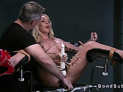 strapped-busty-blonde-in-gyno-chair-pussy-toyed