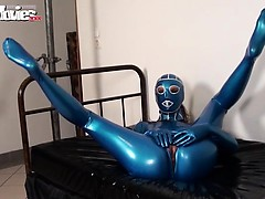 kinky-fiona-in-blue-latex-showing-her-pussy-slit