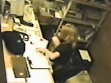Cute blonde caught masturbating at the office