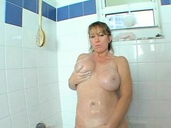busty-horny-mom-rubbing-her-snatch-in-shower