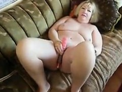 fat-grandma-masturbates-using-her-toy