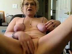 naughty-grandma-masturbating-with-her-toys