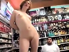 ugly-redhead-naked-in-public-at-a-shop