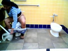 fat-indian-watched-pissing-on-a-toilet
