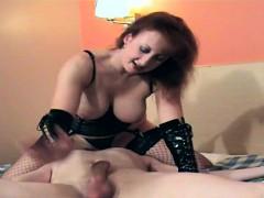 redhead-mistress-in-lingerie-punishing-man