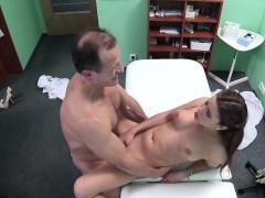 doctor-examining-brunette-in-lingerie