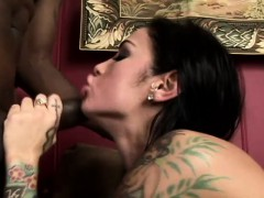 tattooed-hottie-with-big-hooters-has-two-huge-cocks-plowing-her-holes