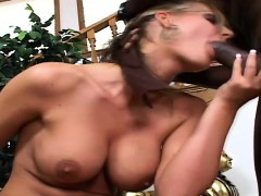 busty-blonde-cougar-has-a-black-stick-working-its-magic-in-her-peach