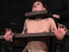 redhead-sub-caned-and-clit-stimulated