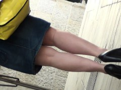 saucy-older-woman-flaunts-her-fine-legs-while-in-her-sexy-s