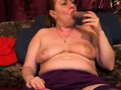 big-breasted-mature-woman-in-stockings-wraps-her-lips-aroun