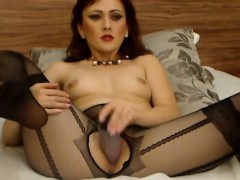 redhead-bitch-on-cam-stabs-dildo-in-her-wet-puss-that-is-se