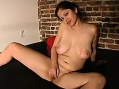 Evie Loves Playing With Her Large Tits And As She Sits