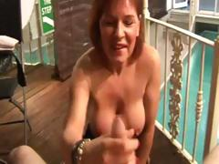 mature-lady-tugs-cock-and-gets-cumshot-from-lucky-guy