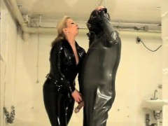 domme-in-latex-lashing-on-his-asshole-in-sadomasochism-and