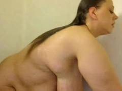 big slut with monster tits taking a shower