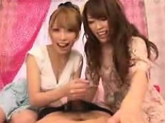 two-mesmerizing-oriental-babes-working-their-hands-on-a-coc