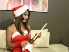 Erotic Santa ladyboy lets her cock hang loosely from panties