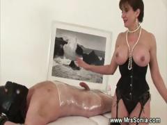 Mistress Jerking Off Her Bound Slave