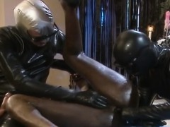 black bitch in leather gets her asshole fisted