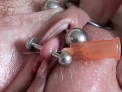 real-clitoris-piercing-and-through-with-a-needle
