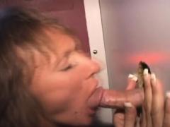 aging brunette amateur taking faical through glory hole