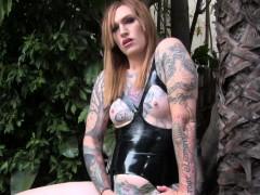 inked-transsexual-in-latex-masturbating