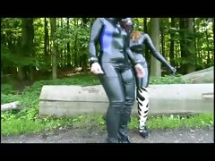 two-girls-in-latex-touch-each-other
