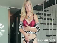 mature-blonde-hottie-stripping-sensually