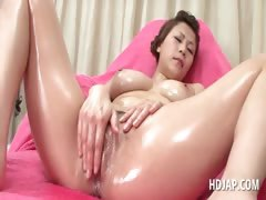 tempting-asian-babe-fucks-her-oily-cunt-with-vibrator