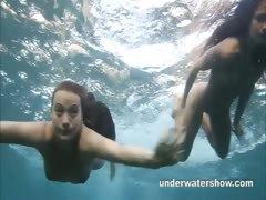 julia-and-masha-are-swimming-nude-in-the-sea