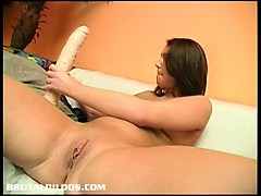 brunette melinda stuffing her pussy with a brutal dildo