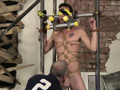 the-boy-is-restrained-in-a-cage-of-metal-and-blindfolded