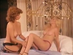 horny-lesbians-in-bed-with-a-toy-classic