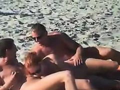 Swingers Having Fun Outdoors At A Beach