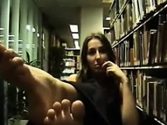girl-teasing-her-feet-at-the-library