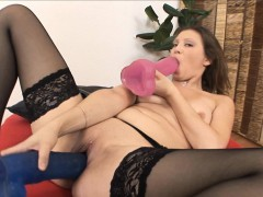 brunette-sucks-on-a-big-dildo-as-another-gapes-her-wet-pussy