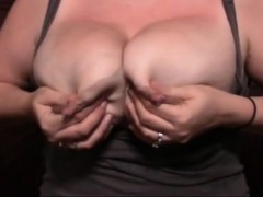 Big breasted Woman Takes Out Her Juicy Tits And Squeezes He