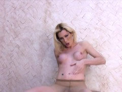 Blonde Plays With Her Long Cock Trapped In Sexy Pantyhose