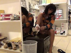 Horny Woman In A Shoe Store Can't Wait To Flash Her Ass And