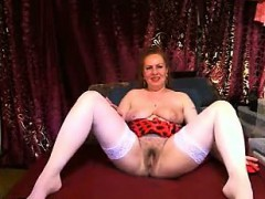 busty-mature-woman-in-white-stockings-spreads-her-legs-for
