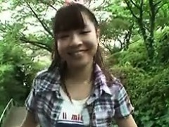 cute-japanese-girl-is-out-for-a-walk-and-has-an-ice-cream-c