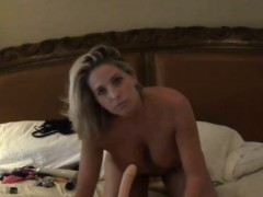 mean-busty-milf-shoving-lingerie-in-pussy