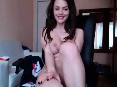 brunette-shows-her-pussy-on-the-chair